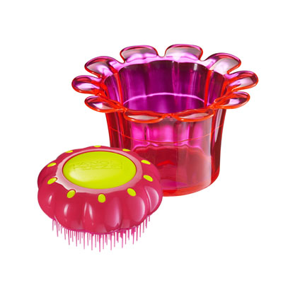 Use the pot to store your hair bands, clips and whatever. The Teezer acts as the 'lid'. Super cute for le kiddies.