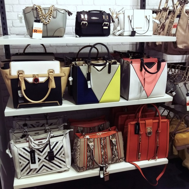 The bag wall at River Island is waiting for you...